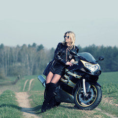 Portrait of attractive girl on sports bike.