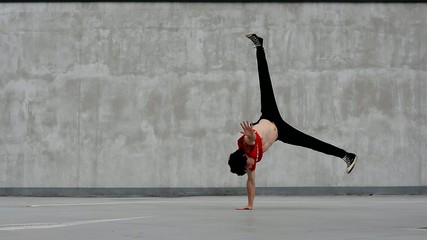 Teenager dancing on the street