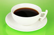 A cup of strong coffee on green background