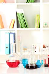 Different laboratory glassware with color liquid