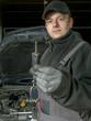 Auto mechanic with car key