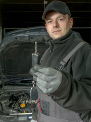 Auto mechanic with car key