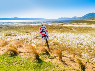 Crocodile warning and no swimming sign, South Africa