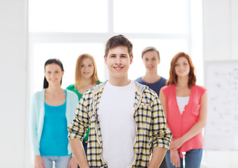 smiling male student with group of classmates