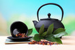 Black teapot, bowl and tea