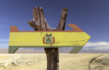 Bolivia wooden sign with a desert background