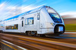 canvas print picture - Modern high speed train with motion blur