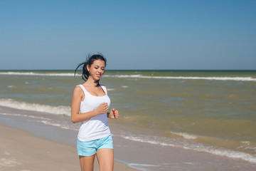 Young girl runs on the sea