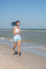 Young girl runs on the sea