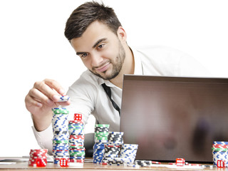 Man stacking poker chips money concept