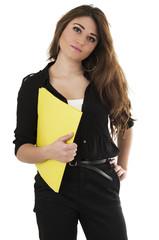Pretty hispanic young student holding a yellow folder
