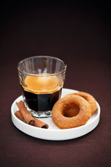 Donuts with cinnamon and coffee, selective focus