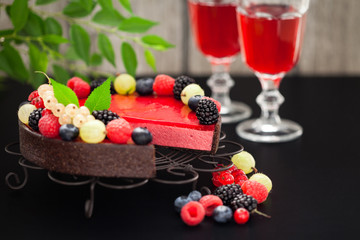 Chocolate raspberry tart with fresh berries, selective focus