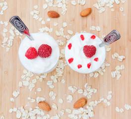 Dessert of raspberries, oats, nuts, cream