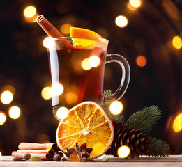 Mulled wine, blue pine tree branch and spices