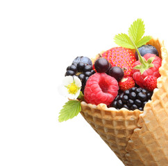 Summer berry fruits in cone.