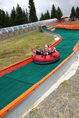 Girls on the summer ski slide