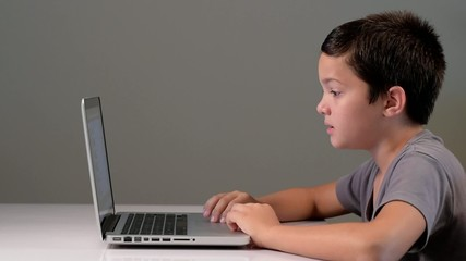Young child on the phone and laptop