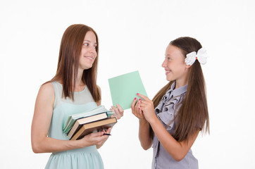 The teacher gives the student a proven notebook