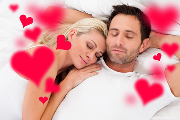 Loving Young Couple Sleeping In Bed