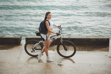 The beautiful woman with the bike