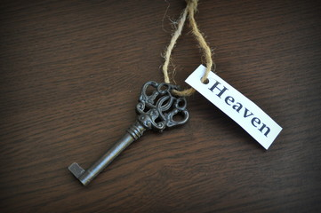 Key on the table with a note written on it key to heaven closeup