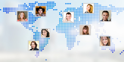 Photo of people at world map.
