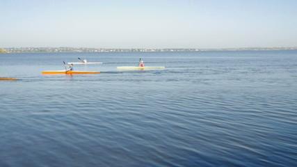 children traveler kayaking in the river