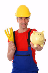 worker with folding yardstick and piggy bank