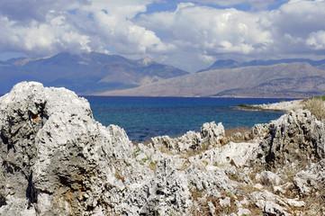 coast of island of Corfu with white rock.