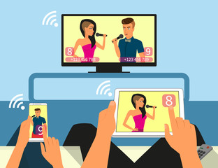 Multiscreen interaction. Man and woman are participating in TV