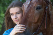 Young woman with horse - 68282349