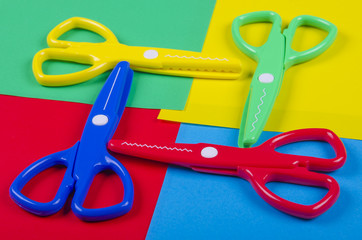 Set for creativity with colored paper and plastic scissors