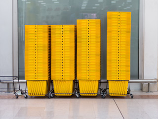 pile of yellow shopping basket in super market