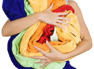 Woman holding a lot of colorful laundry in her hands, Isolated o