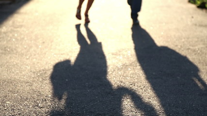 Young couple in love shadow on the sidewalk