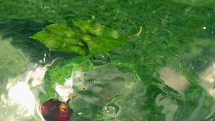 Cherries falling into water, closeup, slow motion shot at 240fps