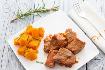 Pork stew garnished with pumpkin