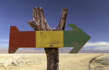 Guinea wooden sign with a desert background