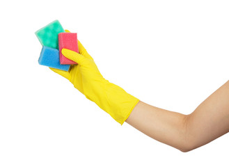 Female hand in yellow glove holding with colorful sponges