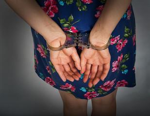 Female hands in handcuffs