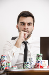 Nervous poker player biting chip