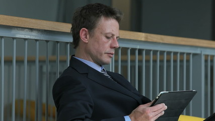 businessman use the tablet on a business trip