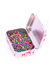 Box of sewing pins in metall box isolated with clipping path
