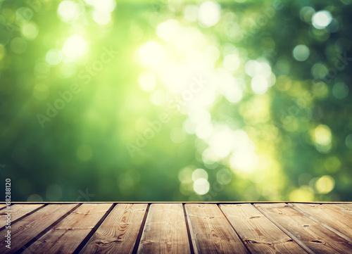 Keuken foto achterwand Bossen wooden surface and sunny forest