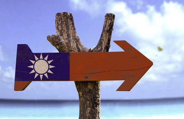 Taiwan wooden sign with a beach on background