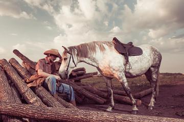 cowboy and horse at farm lumbers