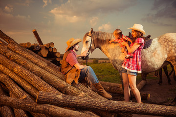 farm family with horse at summer sunset