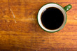 Cup of black coffee  on wooden background.