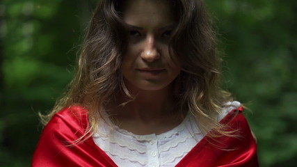 Mysterious woman in red cape in forest, super slow motion,240fps